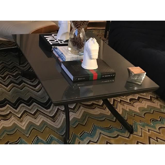 Ligne Roset YoYo table in anthracite glass by French design duo Pagnon & Pelhaître. This table is highly functional as...