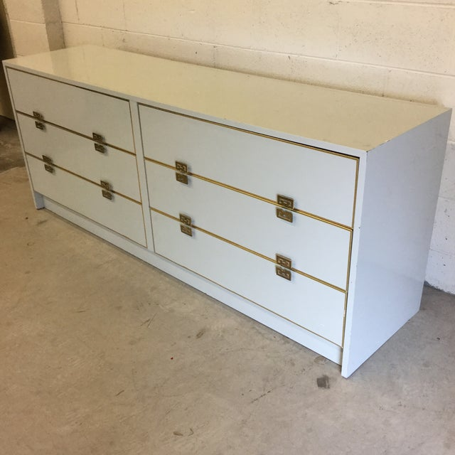 Great 6 drawer white glossy laminate dresser with Greek key brass pulls. Drawers slide easily. Solid construction and...