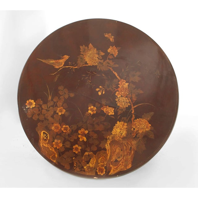 English Queen Anne style round chinoiserie rust lacquer floral design coffee table (20th century).