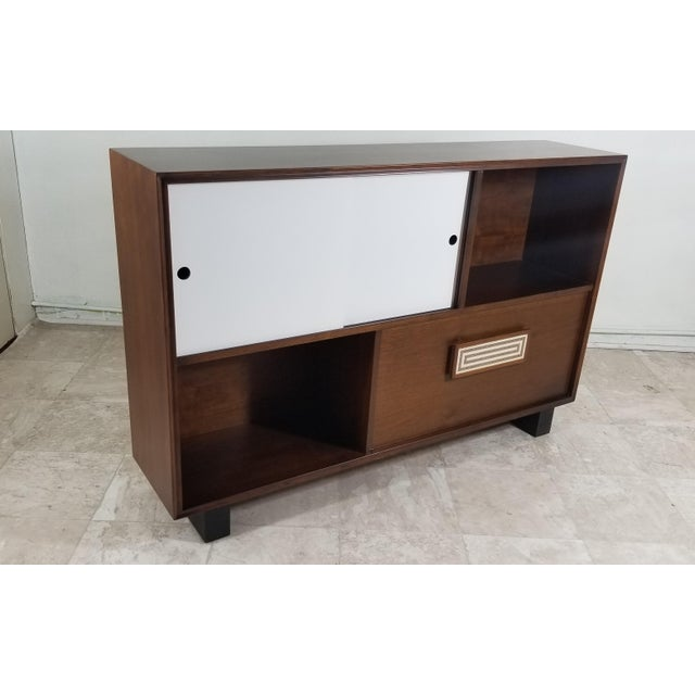 Very cute cabinet made out of walnut wood, refinished condition Porcelain handle circa 1950's Very narrow only 12""
