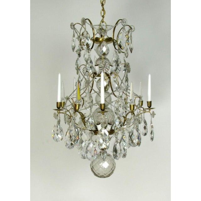 Gorgeous Swedish brass and crystal chandelier. Lights have been added to the interior around the stem, the original candle...