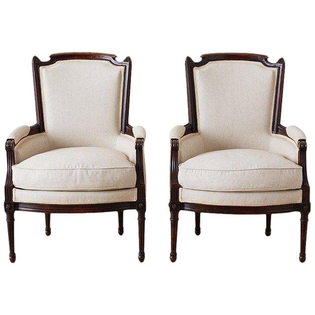 Pair of Maison Jansen Louis XVI Style Walnut Bergères For Sale