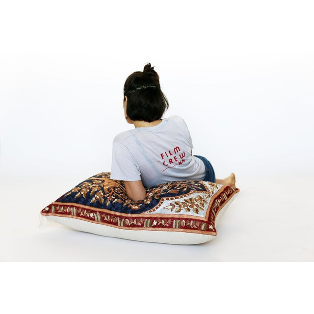 Floor pillow made from an intricately embroidered prayer rug with canvas backing. The scene depicts 4 birds in a tree.