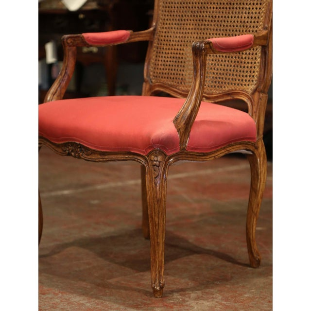 Add a pop of color to your office with this elegant, Louis XV style walnut armchair. Crafted in France circa 1920, the...