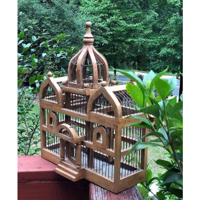 Antique wooden bird cage. A very cool curiosity!