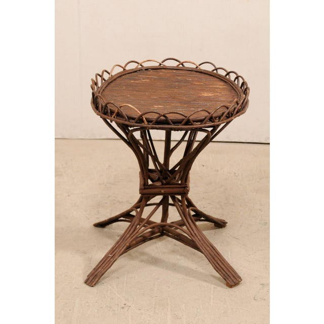 A Swedish early 20th century twig and reed table. This antique table from Sweden features a reeded oval top, with...