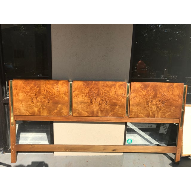 Simply stunning vintage midcentury Thomasville king headboard. It is olive wood burled with brass trim. Brass trim is in...