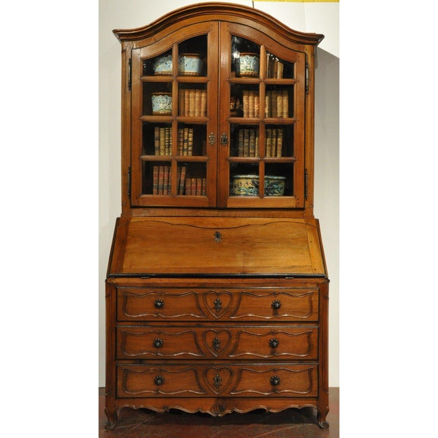 """Exceptionally useful and beautiful, this elegant antique fruitwood """"secretaire a abattant"""" or """"Dos d'Ane"""" (secretary..."""