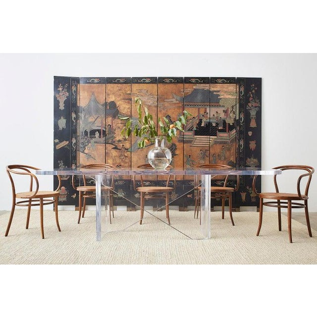 Monumental lucite acrylic moderne dining table made in Italy featuring a 2 inch thick sculptural base. The ingenious base...