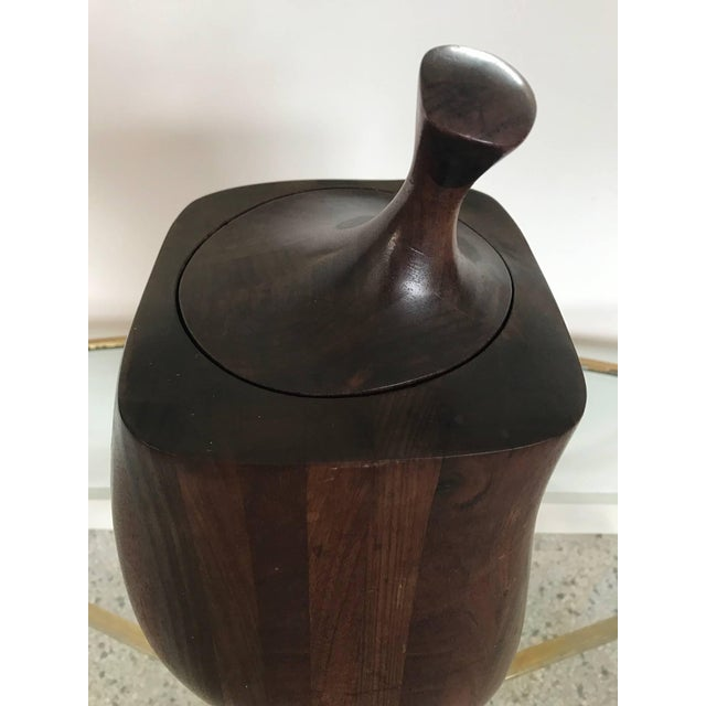 An unusual ice bucket by Daniel Loomis Valenza, circa 1970s. Laminated, stacked walnut with aluminium lining.