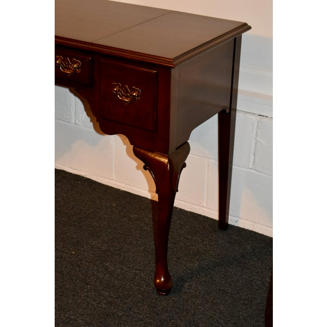 Vanity Desk has a Queen Anne Style. Made by Ethan Allen. The vanity has a flip-top with a mirror, four compartments, and...