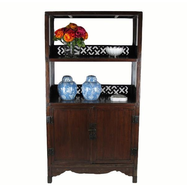 This large cabinet displays masterfully carved lattice railings, offering a distinctive Asian style with a high level of...