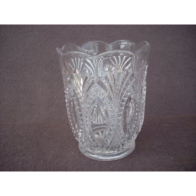 Vintage early 1900's pressed glass in a design typical of the era; scalloped top edge; designed to hold extra spoons on...