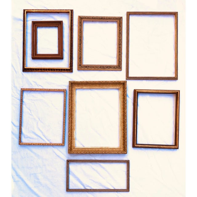 Wonderful set of eight vintage frames ready for your art. Create a beautiful gallery wall. Smallest frame measures...