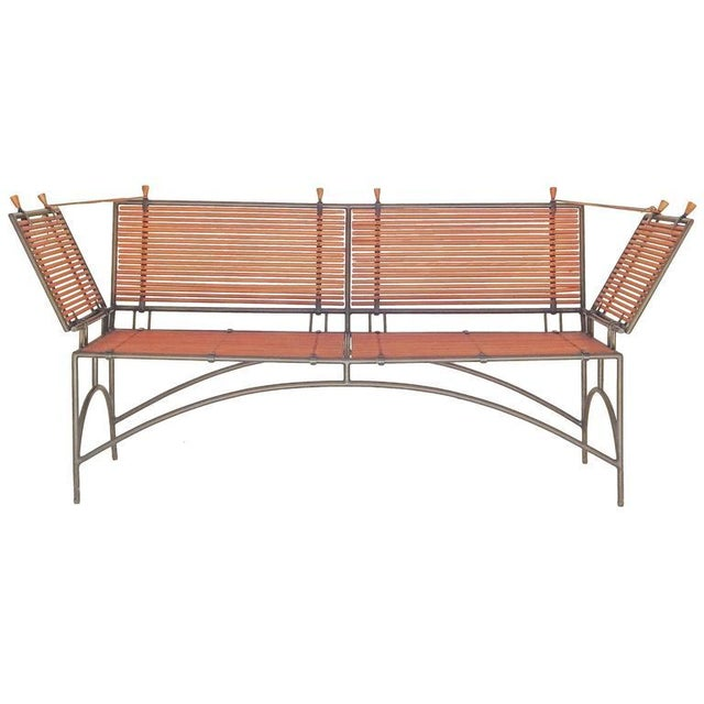 Wood reeded Knole style bench or settee with iron frame.
