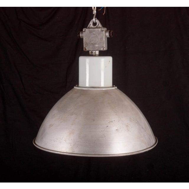This pendant lamp was used in a factory in Czechoslovakia in the 1960s. It is made of a gray aluminum lampshade with a...