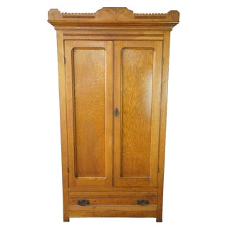 Late Victorian Antique Carved Oak Clothing Armoire For Sale