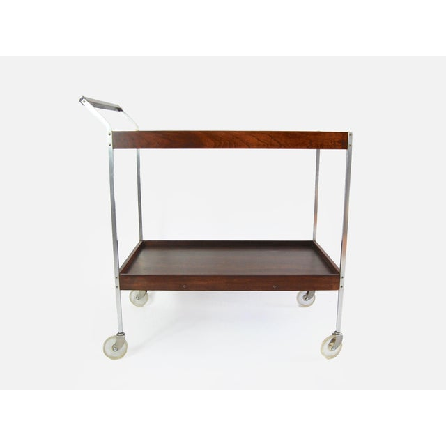 Mid Century Modern Salton hot plate serving cart in the style of George Nelson. The cart has a modern streamlined design...