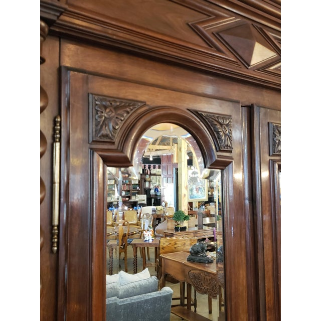 The long barley twist turnings on this mirrored Louis XIII period walnut armoire really take its look to another level. It...