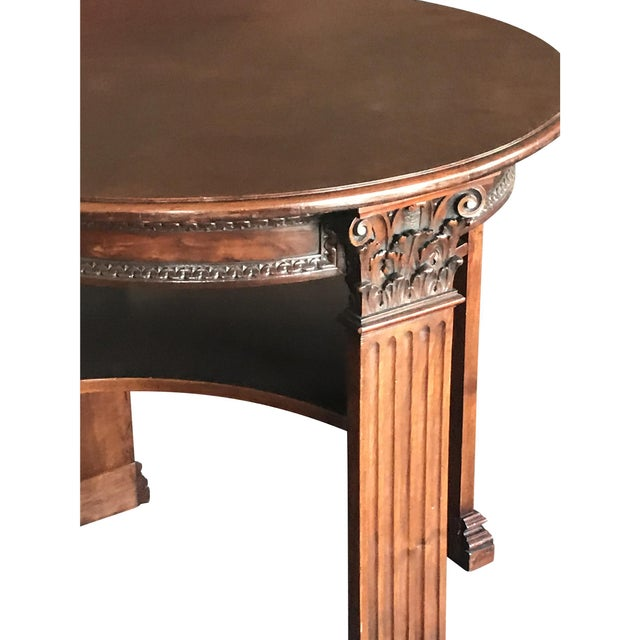Antique English mahogany center table. The piece dates back to the mid 19th century.