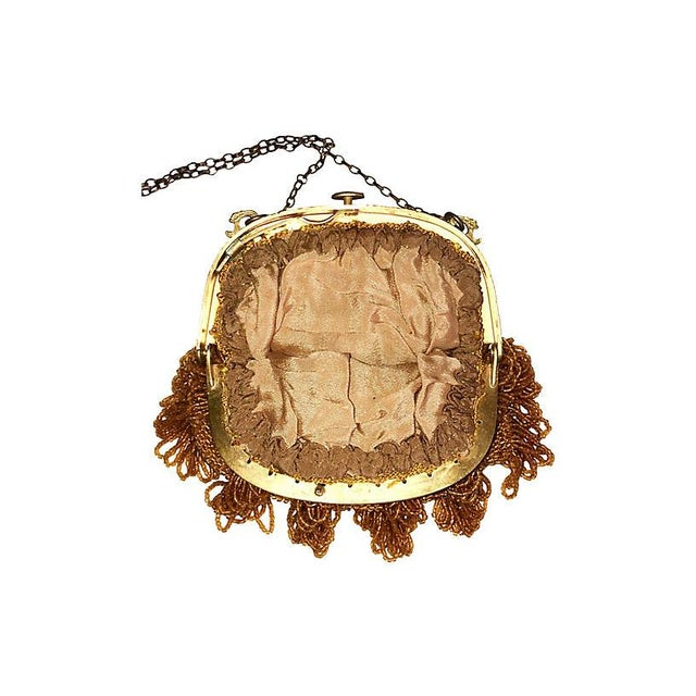 1920s glass beaded purse attached to an ornate goldtone metal frame with pull tab and embellished with looped beaded...