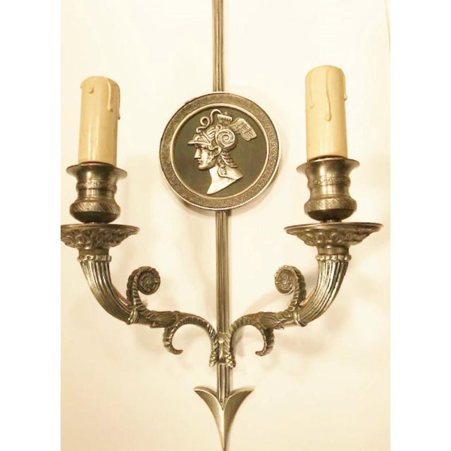 """A fabulous pair of """"Directoire"""" style 2-lite French sconces. This exact pair pictured in an archive catalog of """"Maison..."""