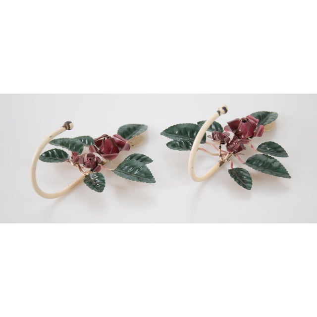 A gorgeous pair of Mid-Century Italian tole hand painted red flowers with green leaves hooks. These lovely floral hangers...