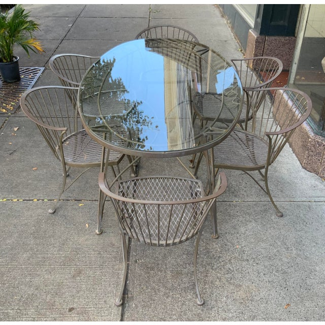 A vintage 1950s wrought iron garden dining set by Woodard. 'Pinecrest' was one of their most charming designs in the...
