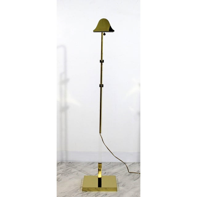 For your consideration is a fabulous, adjustable, floor lamp, made of Lucite and brass, in the style of Bauer and Kovacs....