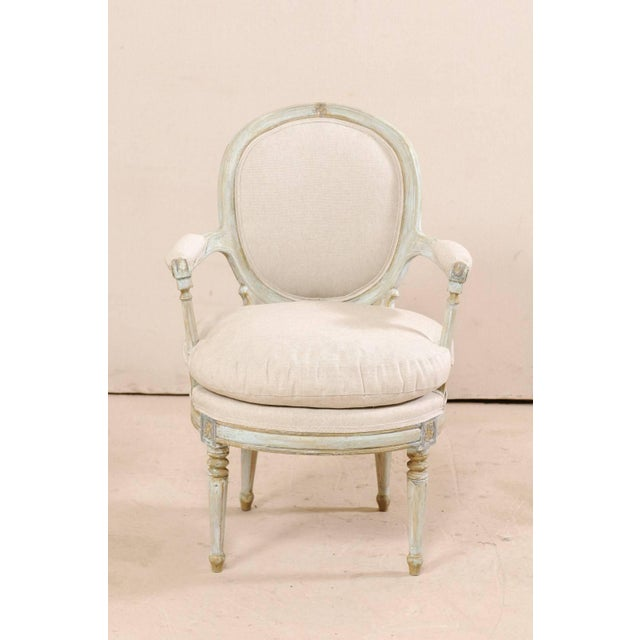 Pair of French Oval-Back Bergère Chairs With Delicately Carved Floral Motifs For Sale In Atlanta - Image 6 of 11
