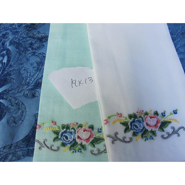 A pair of hand embroidered linen guest towels, freshly starched and pressed.