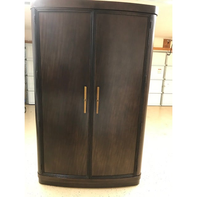 3 large drawers, 3 fixed cubby holes, one adjustable shelf with outlet for TV/electronics. Seller is original owner and it...