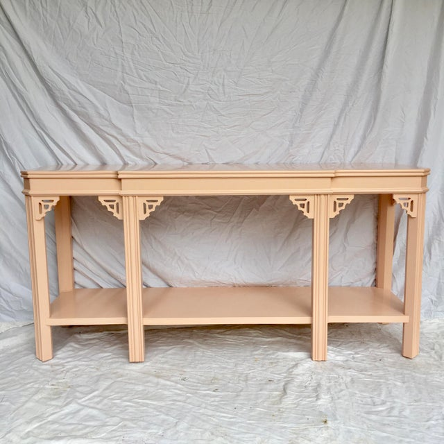 This gorgeous traditional console table with fretwork corners made by Lane has been newly lacquered in a sophisticated...