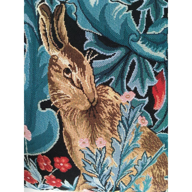 Beautiful William Morris style tapestry pillow cover, with gold cord trim, features a rabbit in a woodland scene.