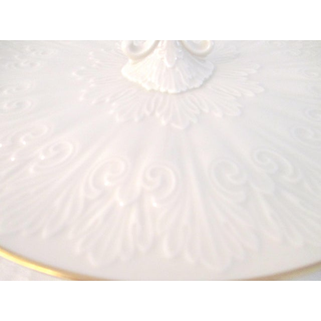 Lovely Lenox cream-shaded porcelain petite four serving platter featuring an embossed ornate design on face with 22 karat...