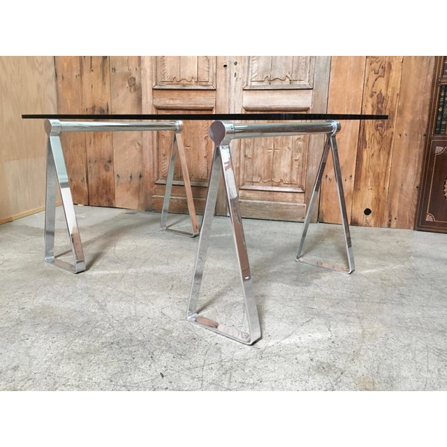 "Professionally polished aluminium sawhorses with 3/4"" thick glass top Chair in picture is sold separately. Made in the mid..."