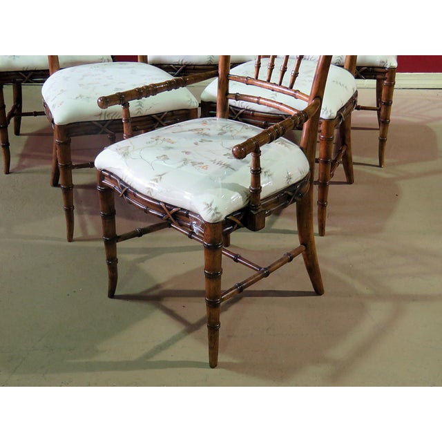 """Set of 6 faux bamboo dining room chairs with upholstered seats. The 2 arm chairs measure 40""""h x 22""""w x 21""""d with a 20""""..."""