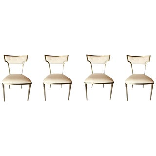 Caracole Modern What Goes Around Brass and White Dining Chairs Set of Four For Sale
