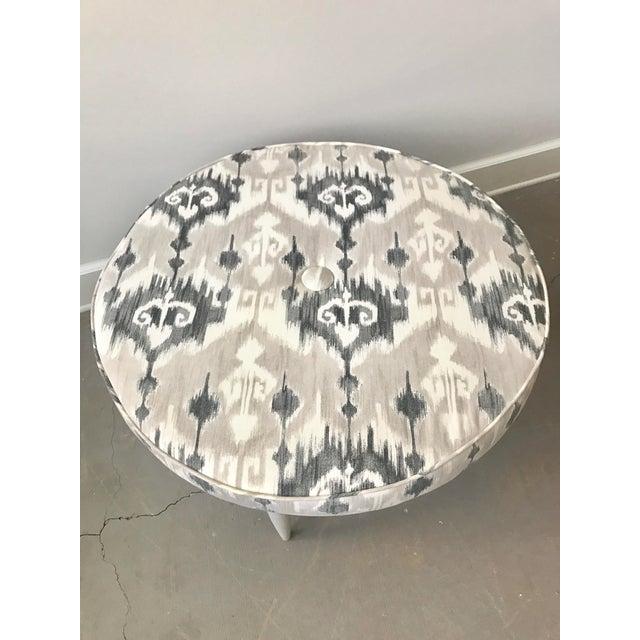 "Mid Century table renewed into a one of a kind ottoman. New 4"" foam, batting & Ikat fabric. Base Finish Benjamin Moore..."