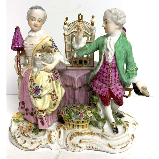 19th century Meissen Birdcage grouping, an unusual grouping, the double figure with a lady of the court holding a dog and...