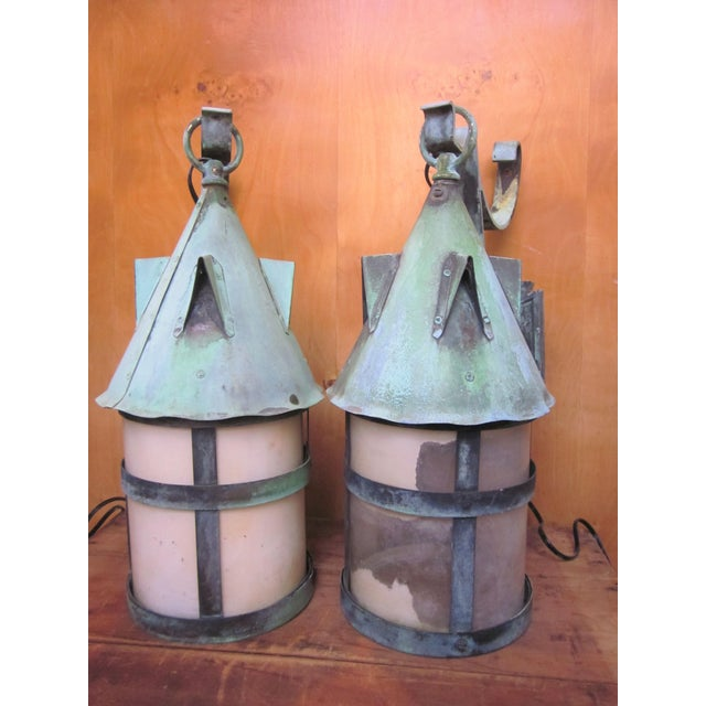 This is an absolutely stunning pair of antique 1910s Arts and Crafts era lantern sconces with modern updated wiring. They...