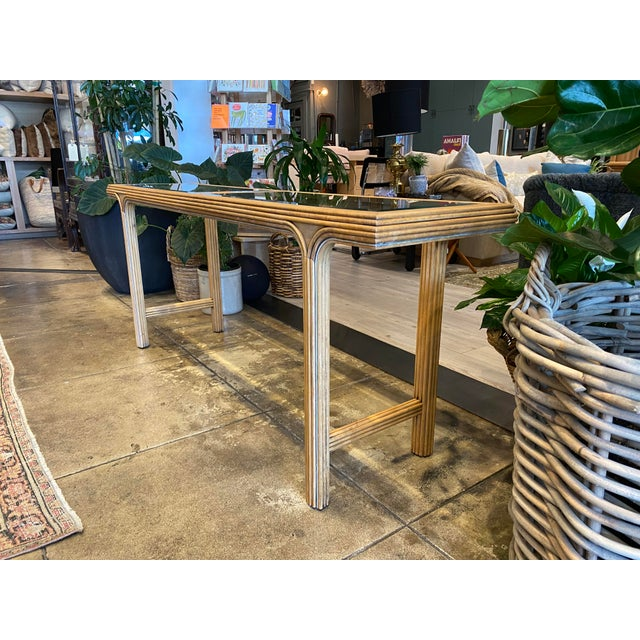 Stylish Art Deco Style Console With Glass Top. Skinny enough for a passage way, or at the back of a sofa. On display at...