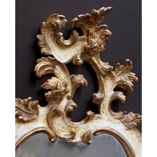 A Fanciful Venetian Rococo Revival Ivory Painted and Parcel-Gilt Cartouche-Shaped Miror Preview