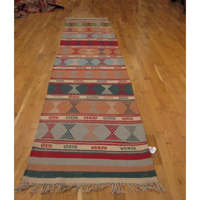 Multi-colored runner, hand-woven in Turkey with embroidered design; new.