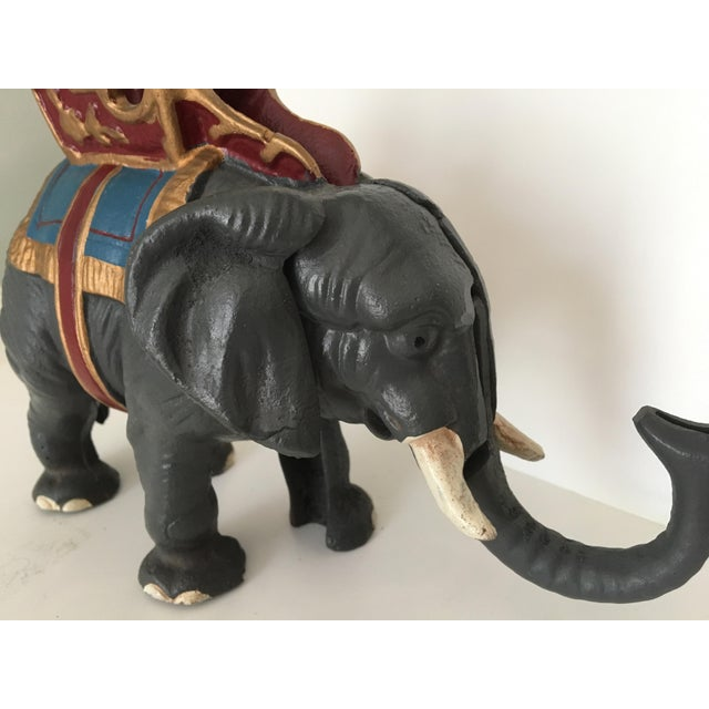 Gray cast iron painted circus elephant bank and is in good working order. The trunk holds a penny and when you pull his...