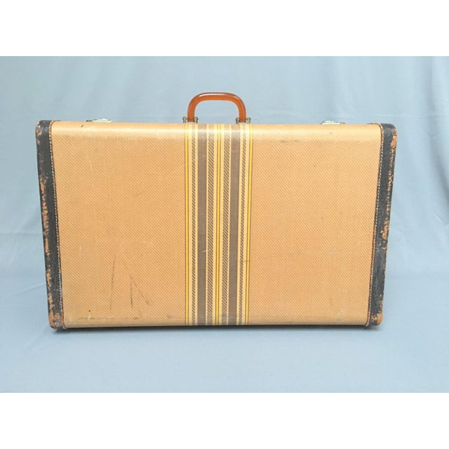 Vintage suitcase ca. 1940s-1950s, with a tweed-look striped exterior, leather trim, tarnished metal and brass locks,...