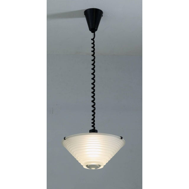 "Art Deco meets Industrial in this pendant light (""Egina"") by Angelo Mangiarotti for Artemide, Italy. Satin black metal..."