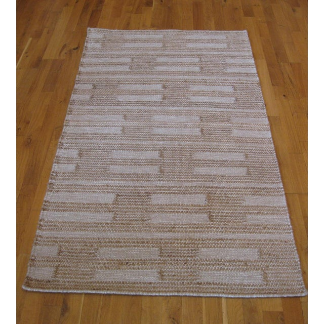 Reversible Beige Flat Weave Dot Dash Rug. Hand-knotted in India. 100% wool.