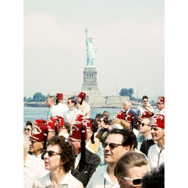 A fun photo from 1964, capturing a boat full of Shriners on the ferry to visit the Statue of Liberty. Sourced from an...