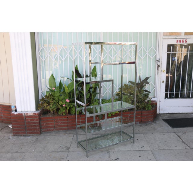 Mid century modern chrome etagere in excellent condition. No damages or chips on glasses. Very sturdy.